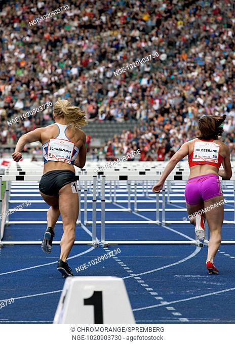 The Germans Nadine Hildebrand and Lilly Schwarzkopf immediately after the start of the 100 meter hurdles at the ISTAF 2012 at the Olympic Stadium in Berlin