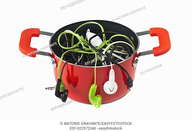 Music headphones in red pot on white background