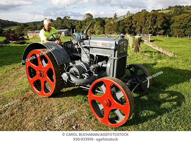A restored antique 1926 Case Cross Engine Tractor being driven by the owner  Note: the owner has supplied a property release for this tractor  However