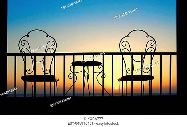 very nice Silhouette of chairs at sunset