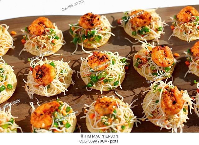 Sesame noodles and chilli prawn canapes