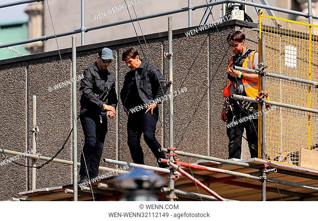 Tom Cruise jumps between two buildings in a scene from the new Mission Impossible film The 55-year-old action man was injured during a big building-jump stunt...