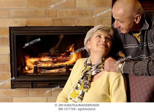 Couple at a fireplace