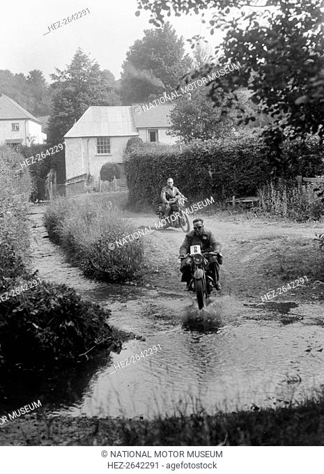 Motorcycles competing in the B&HMC Brighton-Beer Trial, Windout Lane, near Dunsford, Devon, 1934. Artist: Bill Brunell