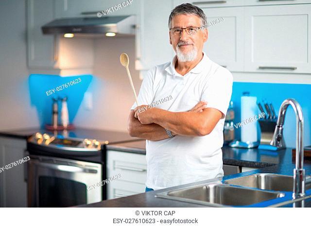 Senior man standing in his renovated, modern kitchen