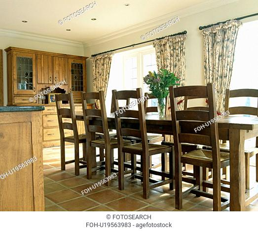 Wooden table and chairs in traditional country kitchen