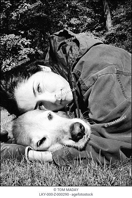 Woman hugging old dog