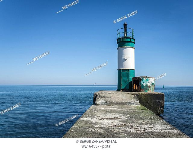 Old lighthouse in the cargo port and container terminal in Odessa, Ukraine