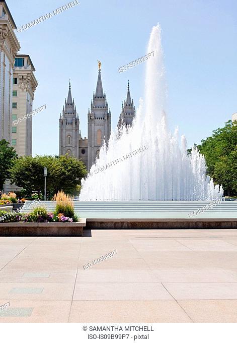 Water fountain and Mormon temple spires, Salt Lake City, Utah, USA