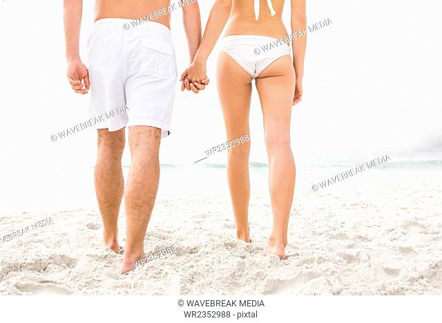 Happy couple posing on the beach