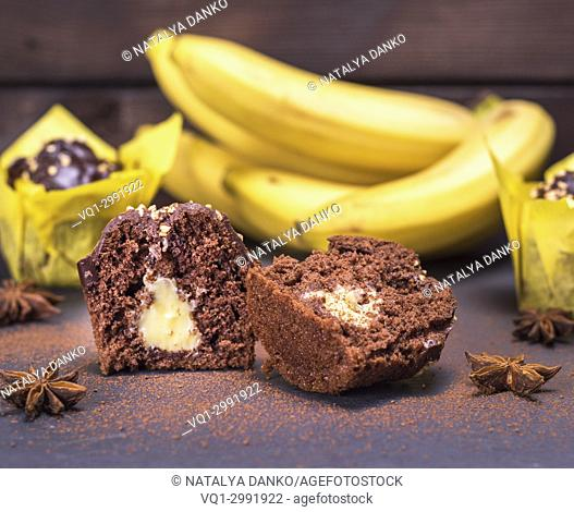 banana chocolate cupcakes with a filling and fresh bananas, close up