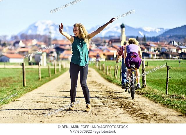 Lively woman on day trip at country side. Waakirchen, Bavaria, Germany
