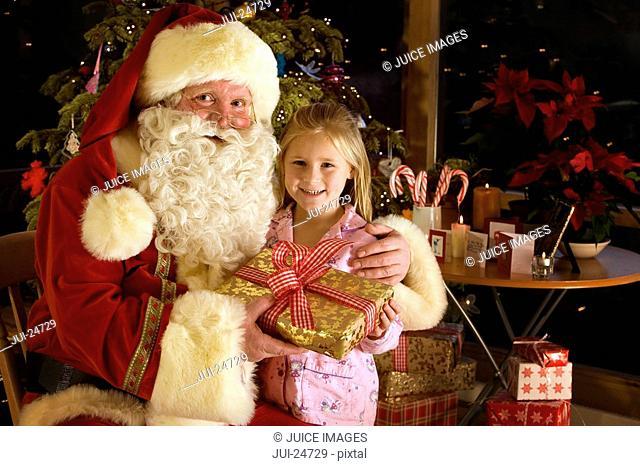Santa and girl holding Christmas gift