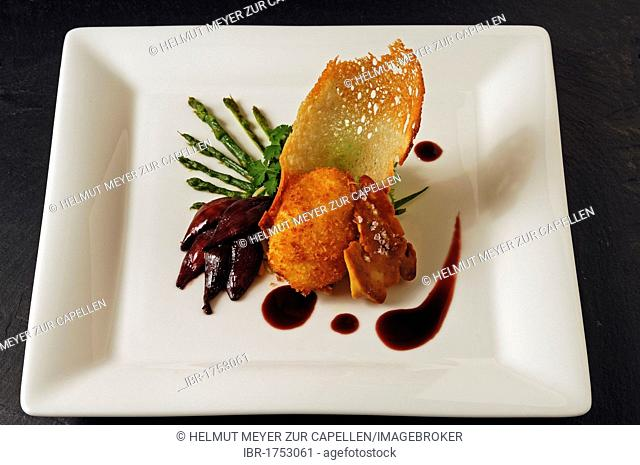 Roasted duck liver with baked poached egg, wild asparagus and red onion confit served on a white plate, food, haute cuisine