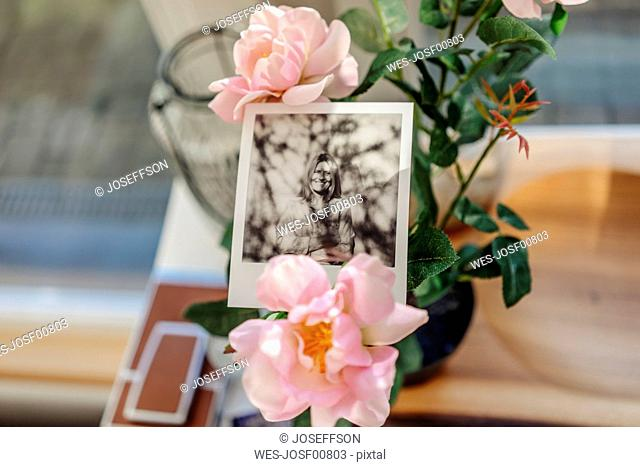 Instant photo of a woman and flower