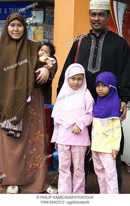 Malay family outside the Geylang market, Singapore