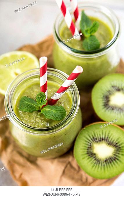Glass of green smoothie and ingredients