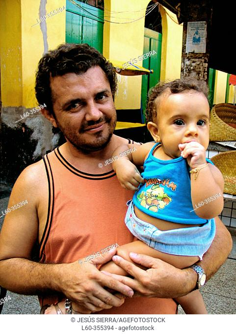 Father and baby. Sao Luis. Brazil