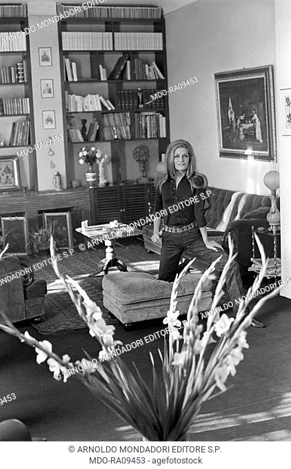 Italian-born French actress and singer Dalida (Iolanda Cristina Gigliotti) posing in the living room her house. Paris, 1968
