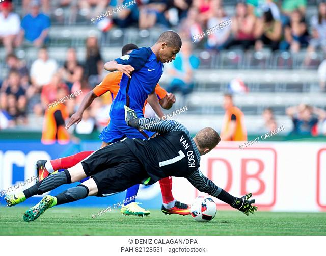 France's Kylian Mbappe (l) in a duel against Netherlands goalkeeper Yannick van Osch during the match of the Preliminary Round, Group B
