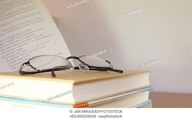 Closeup of open book and eyeglasses. Education concept