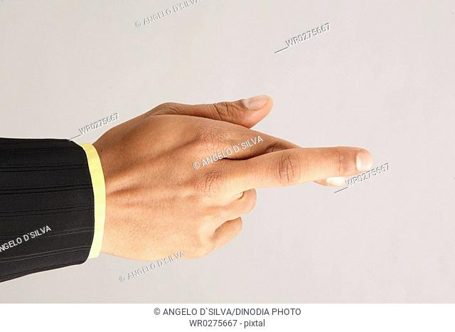 Businessman showing close up of hand kept his index and middle finger crossed MR703T