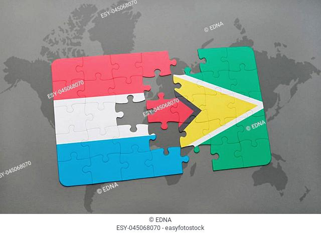 puzzle with the national flag of luxembourg and guyana on a world map background. 3D illustration