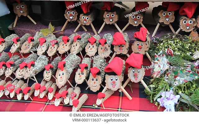 Christmas logs. Cagatió. Christmas market, Sagrada Familia, Barcelona, Catalonia, Spain