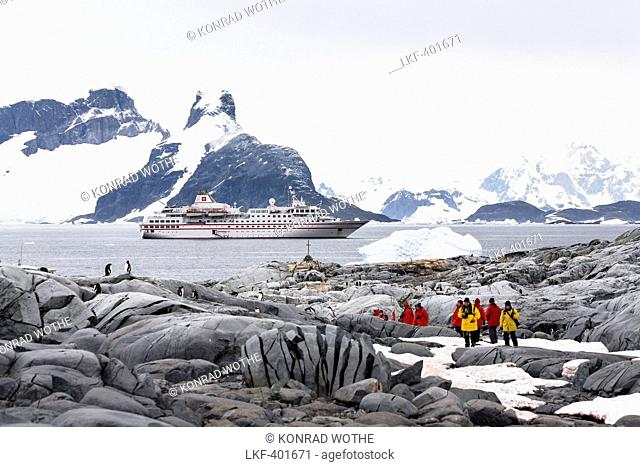 Tourists on Petermann Island off the Antarctic Peninsula, Cruiseship, Antarctica