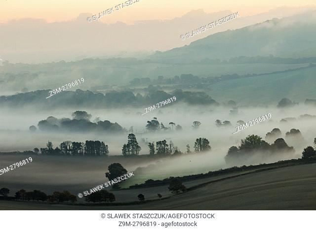 Misty autumn morning in South Downs National Park, East Sussex, England
