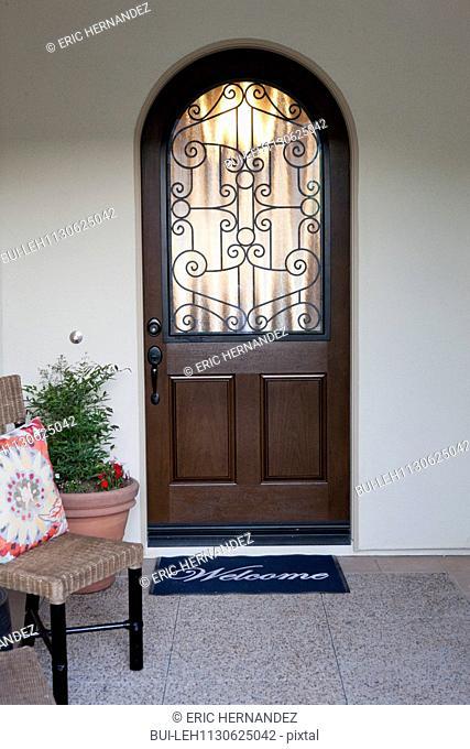 Closed front door with doormat