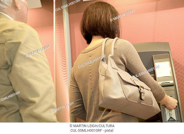 Woman using cashpoint