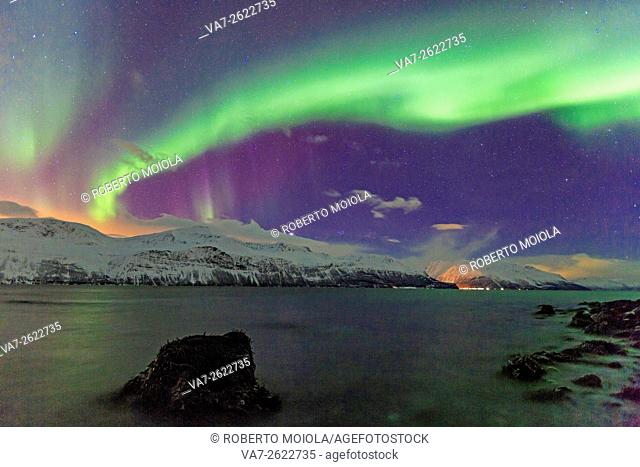 Northern Lights on the icy landscape of Svensby Lyngen Alps Tromsø Lapland Norway Europe