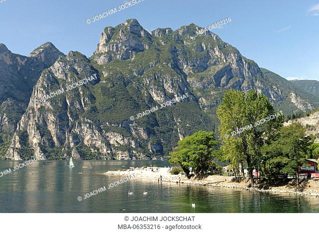 Tourists on the beach of Torbole, Lake Garda, province Trento, Trentino South Tirol, Italy