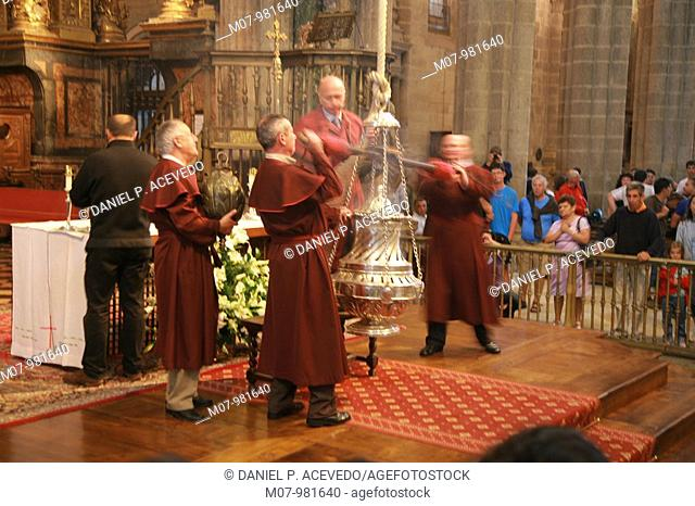 Priests doing the Botafumeiro inside Santiago Cathedral, Galcia, Spain, Europe