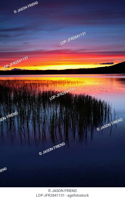 Scotland, Highland, Loch Morlich. Summer sunset over Loch Morlich near Aviemore in the Cairngorms National Park