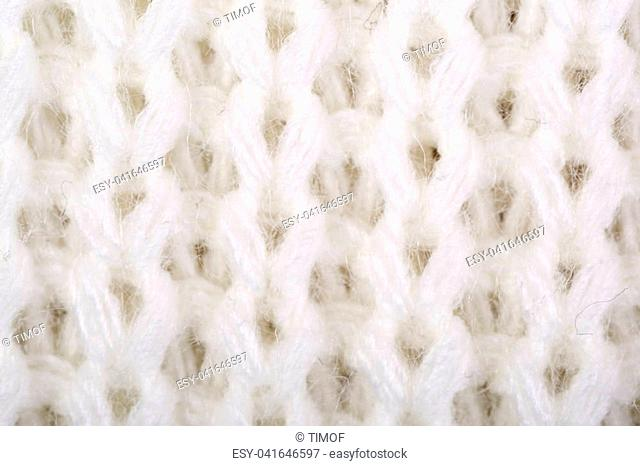 White structure of a knitted woolen fabric background