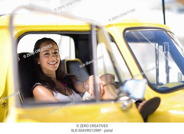 Girl sitting in yellow fun car