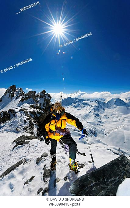 A mountaineer on climb to summit of snowy mountain