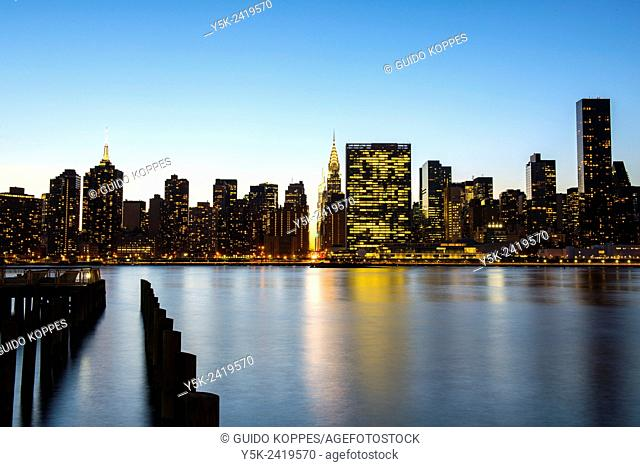 New York, USA. Twilight view on the skyline of Manhattan and the United Nations Head Quarters from Hunters Point, Queens