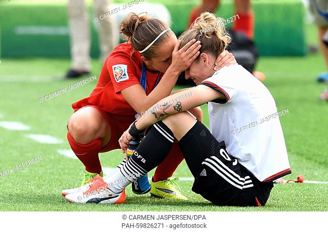 Germany's Simone Laudehr (R) get comfort from Jo Potter from England after the FIFA Women's World Cup 2015 third place soccer match between England and Germany...