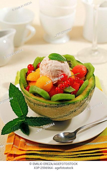 Stuffed melon with fruit and ice cream