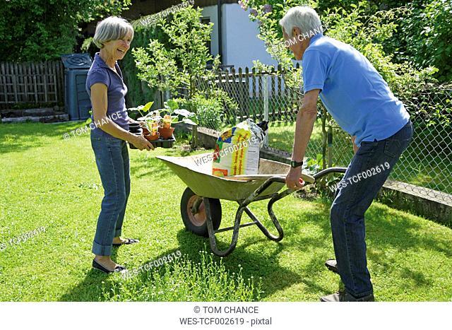 Germany, Bavaria, Senior couple gardening plants