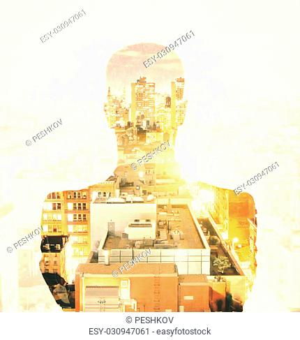 Double explosure with businessman silhouette and city skyscrapers