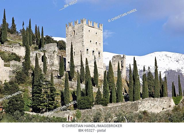 Castle ruin of Arco and in the back the snow covered mountain Mt Baldo, Arco, Lake Garda, Italy