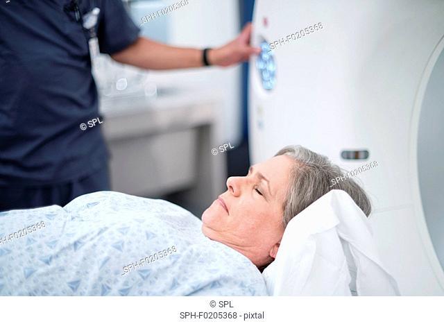 Female patient entering MRI scanner