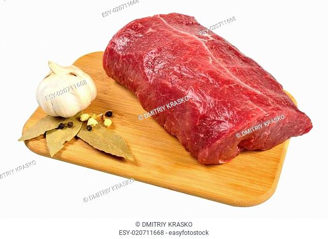 Raw Beef on wooden board