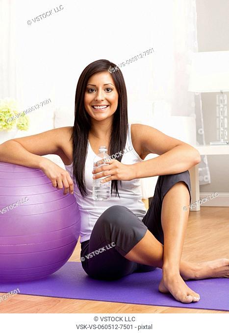 USA, Illinois, Metamora, Young woman with exercise ball