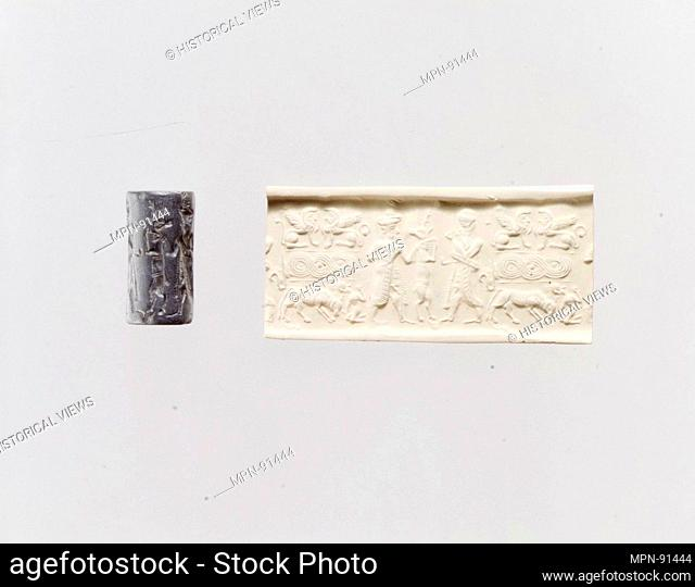 Cylinder seal and modern impression: deity, goat, and worshiper; terminal; sphinxes, guilloche, bull and leaper (?). Period: Old Syrian; Date: ca