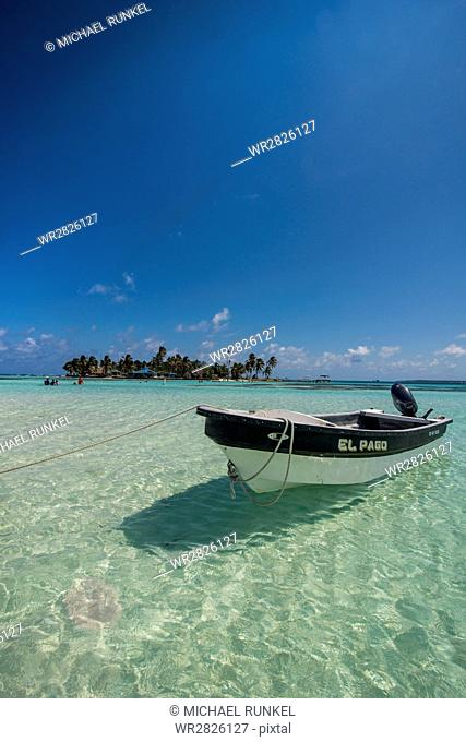 Motorboat anchoring in the turquoise waters of El Acuario, San Andres, Caribbean Sea, Colombia, South America